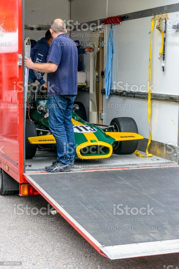 Men unloading a Brabham BT18 vintage  racing car stock photo