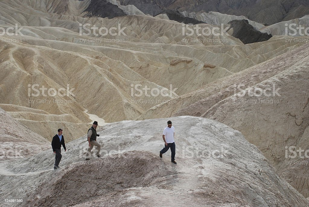 Men Walking up a Path in Death Valley royalty-free stock photo