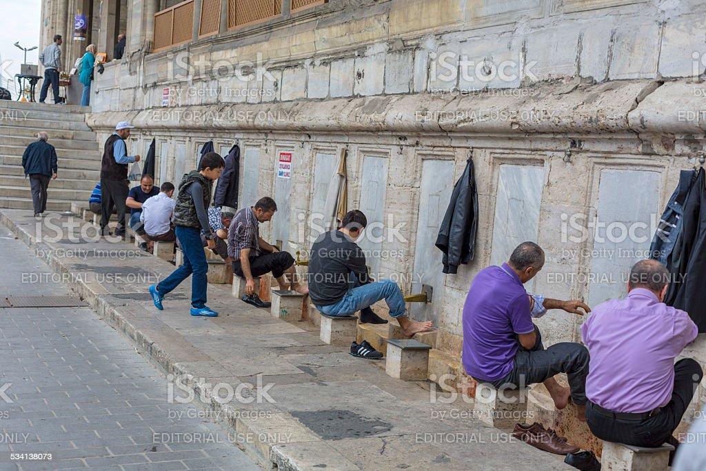 Men Washing Before Praying at Mosque stock photo