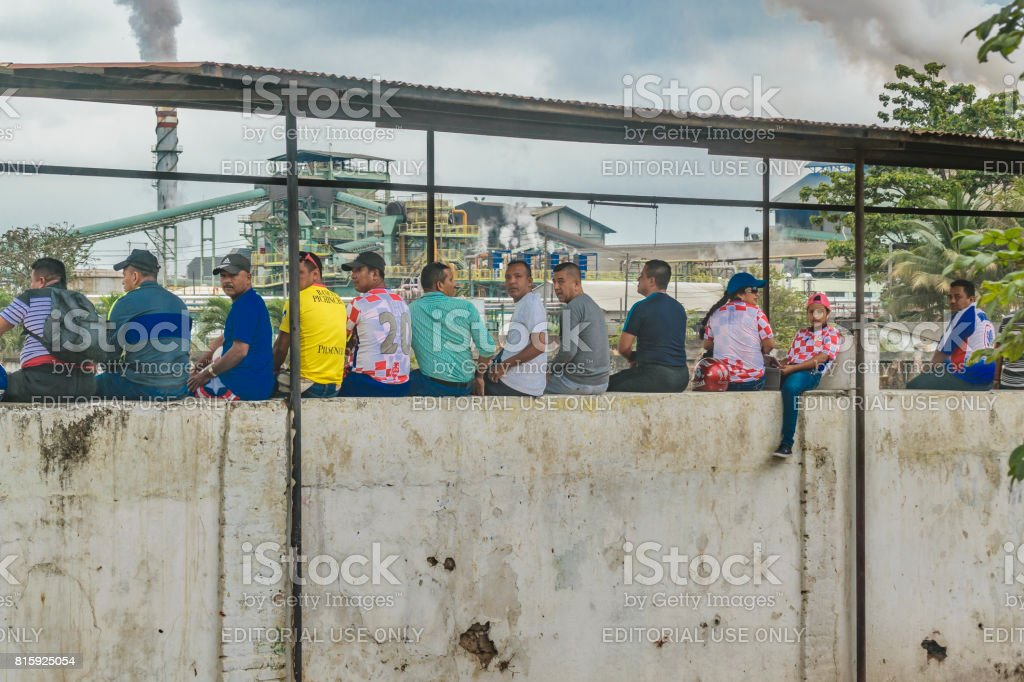 Men Watching a Soccer Game at Poor Town stock photo