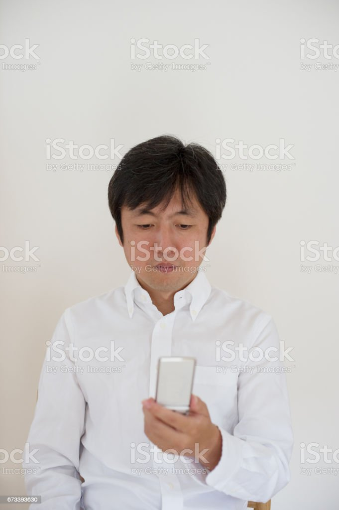 Men watching mobile phones stock photo