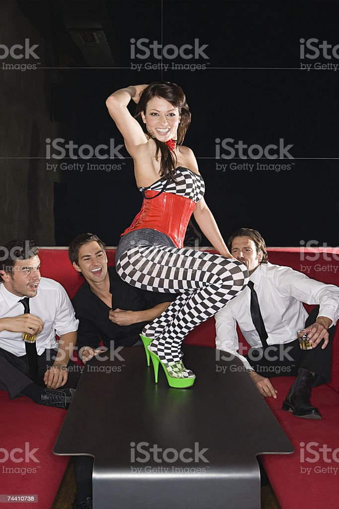 Men watching woman dance on table royalty-free stock photo