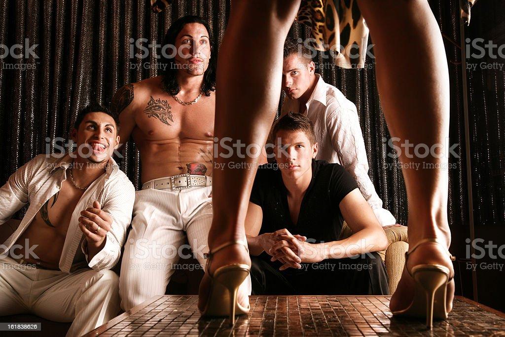 Men watching woman dancing stock photo