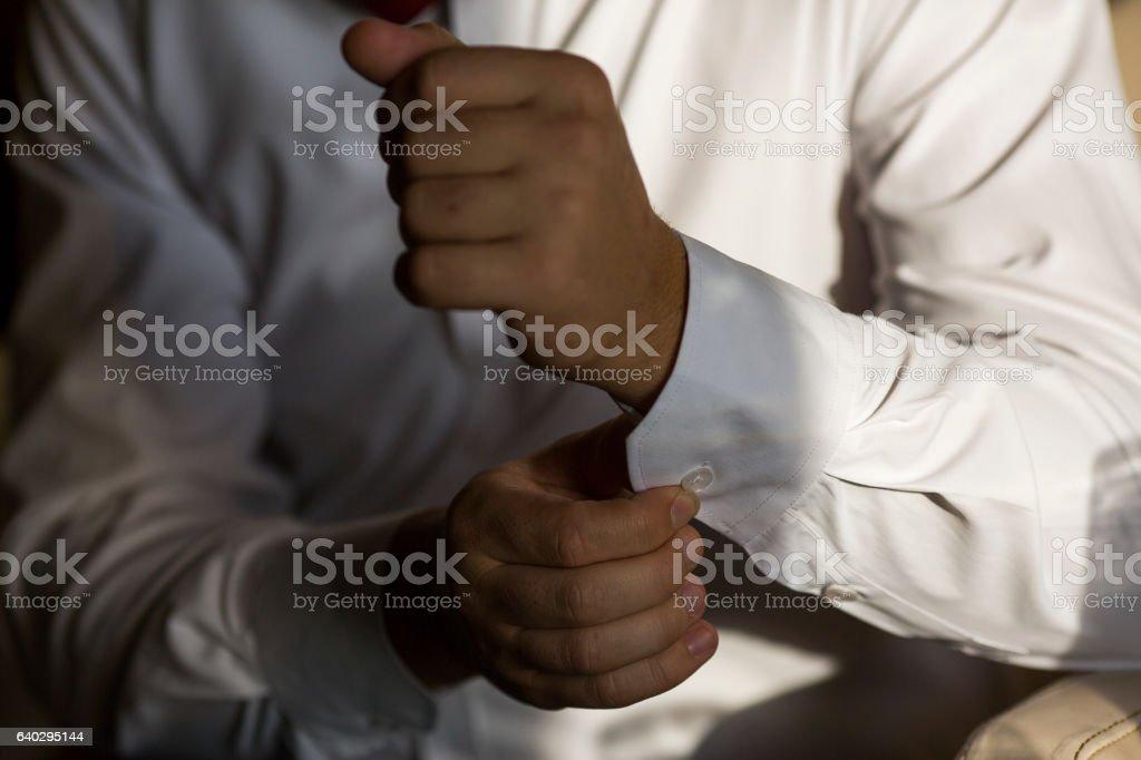 men wear cufflinks on a shirt sleeve stock photo