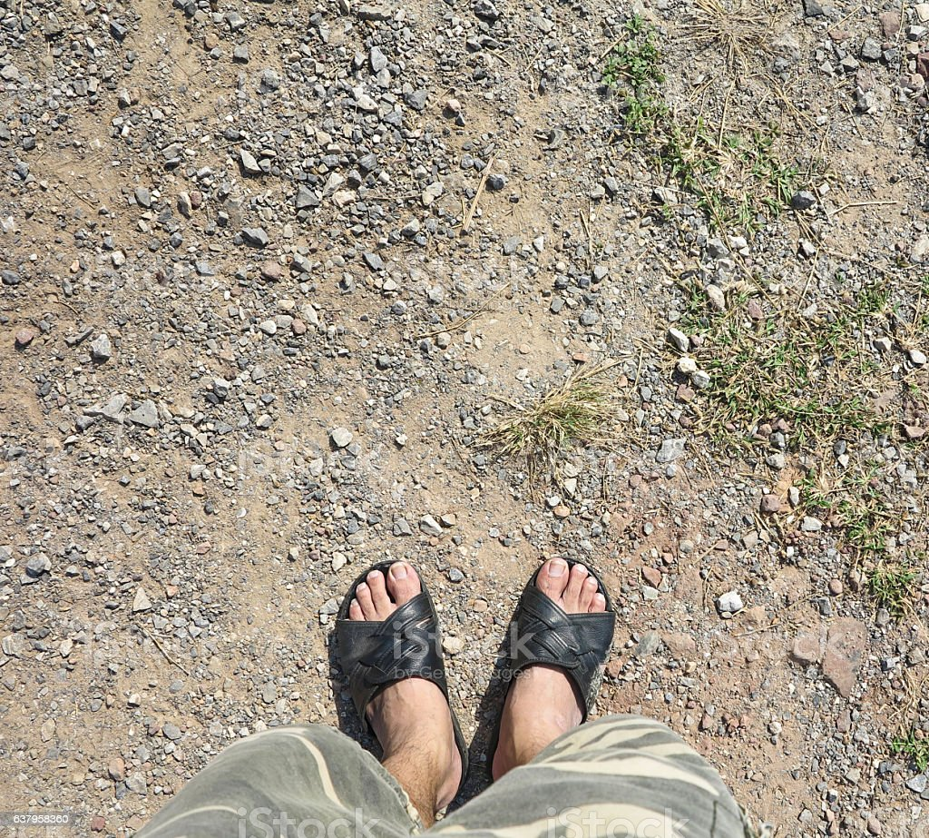 Men wear slippers shoes standing on ground stock photo