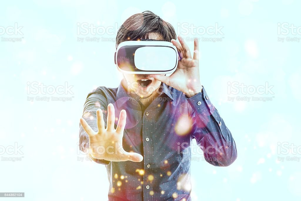 Men wearing goggles, virtual reality stock photo