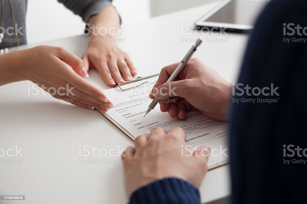 Men who are trying to contract the new house stock photo
