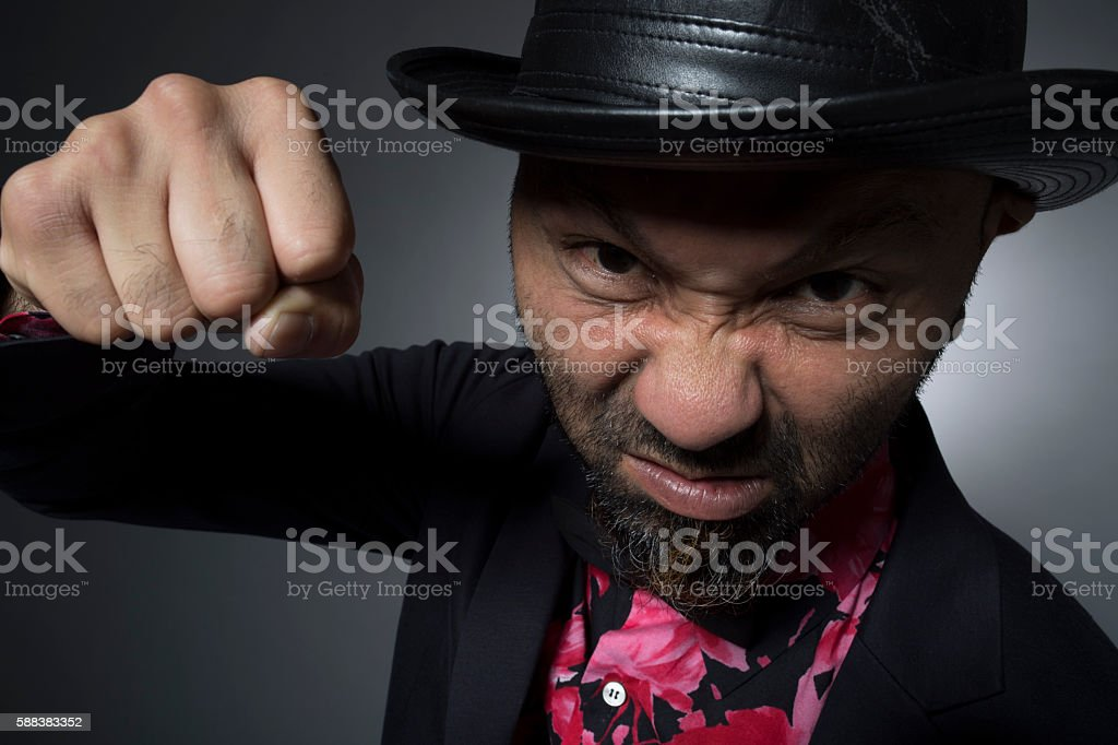 Men who are trying to Naguro a person from sadness stock photo