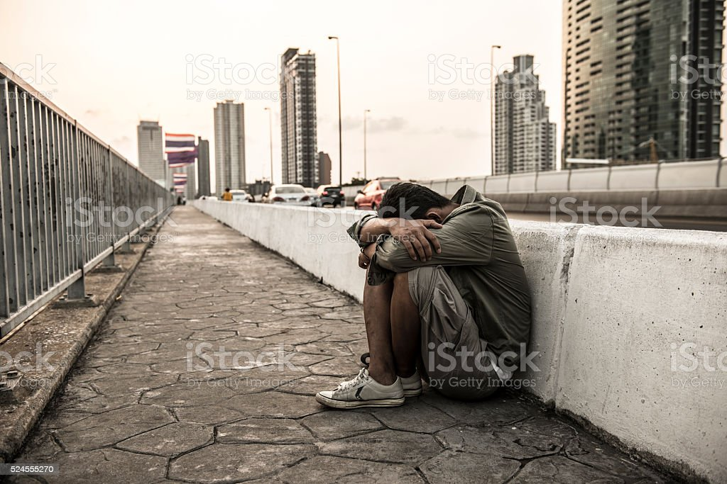 Men who despair of finding a job in the capital. stock photo