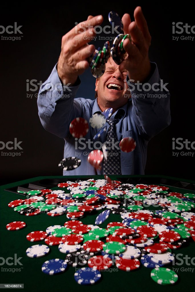 Men Winning at Casino, Throwing Tokens in the Air royalty-free stock photo