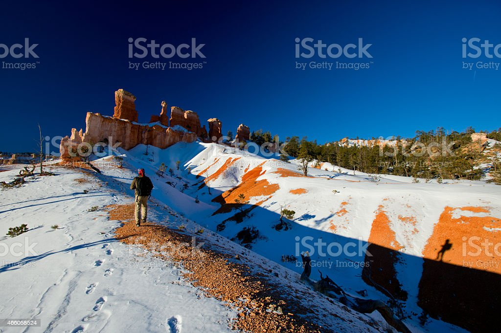 Men with backpack  in Bryce Canyon stock photo