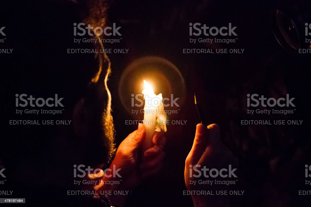 Men with pen and candle for Charlie Hebdo royalty-free stock photo