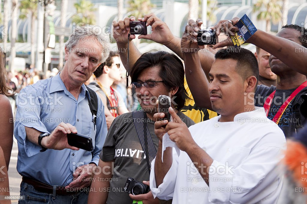 \'San Diego, USA - July 14, 2012: Unidentified men with point and...