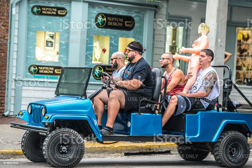 Men with sex doll driving on Duval Street, Key West stock photo