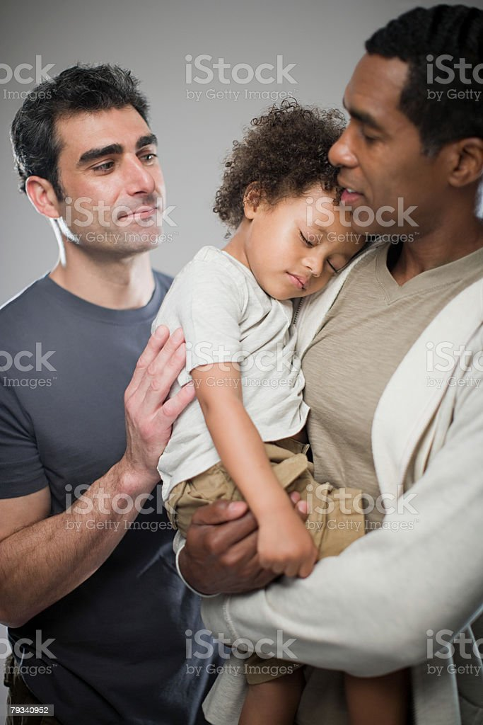 Men with sleepy child stock photo