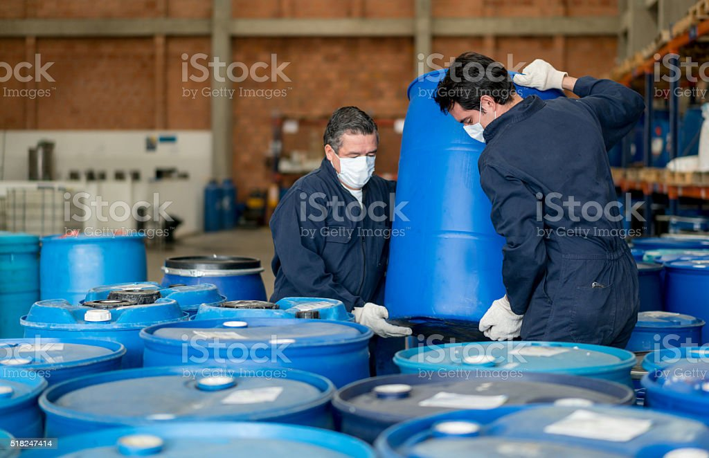 Men working at a chemical plant stock photo