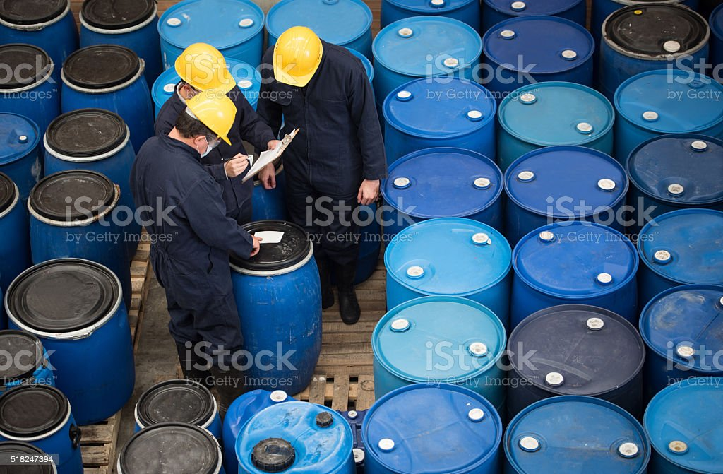 Men working at a chemical warehouse stock photo