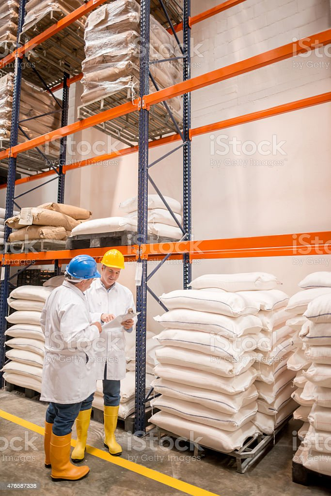 Men working at a distribution warehouse stock photo