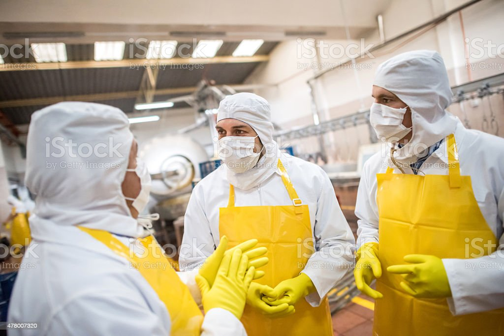 Men working at a food factory stock photo
