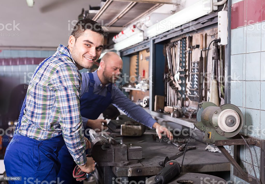 Men working in a workshop stock photo
