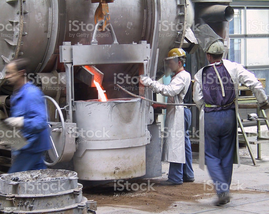 Men working in foundry royalty-free stock photo