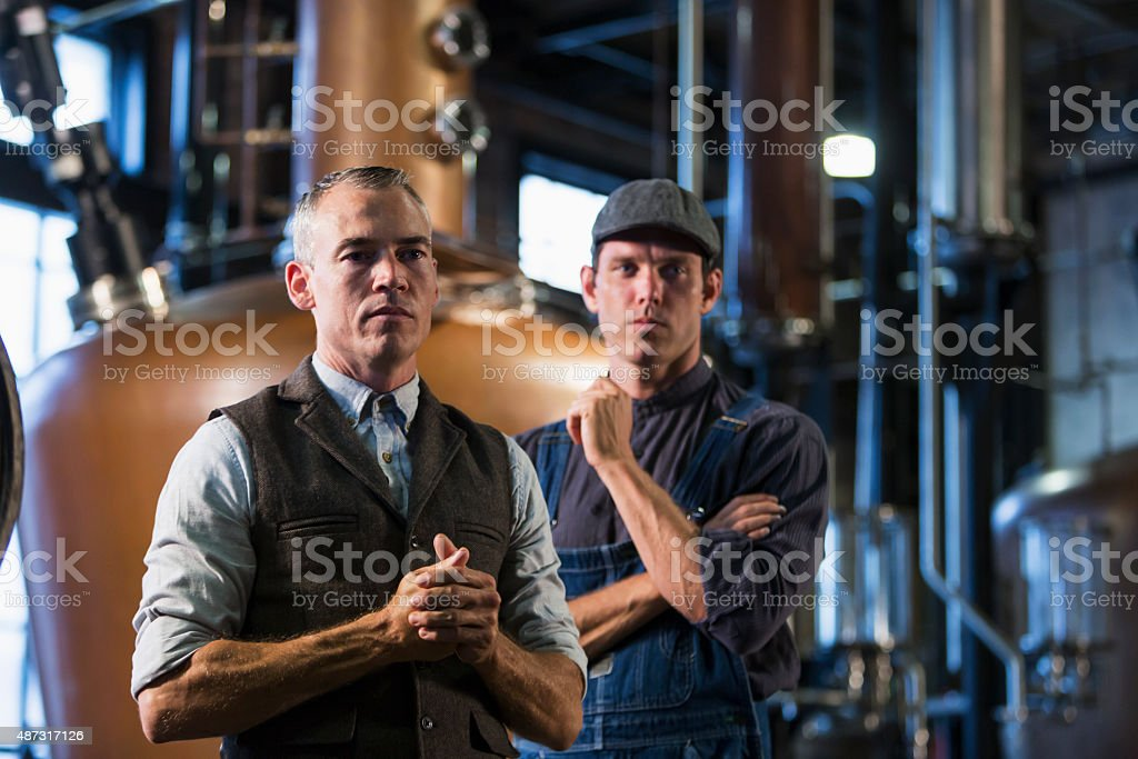 Men working in old distillery stock photo