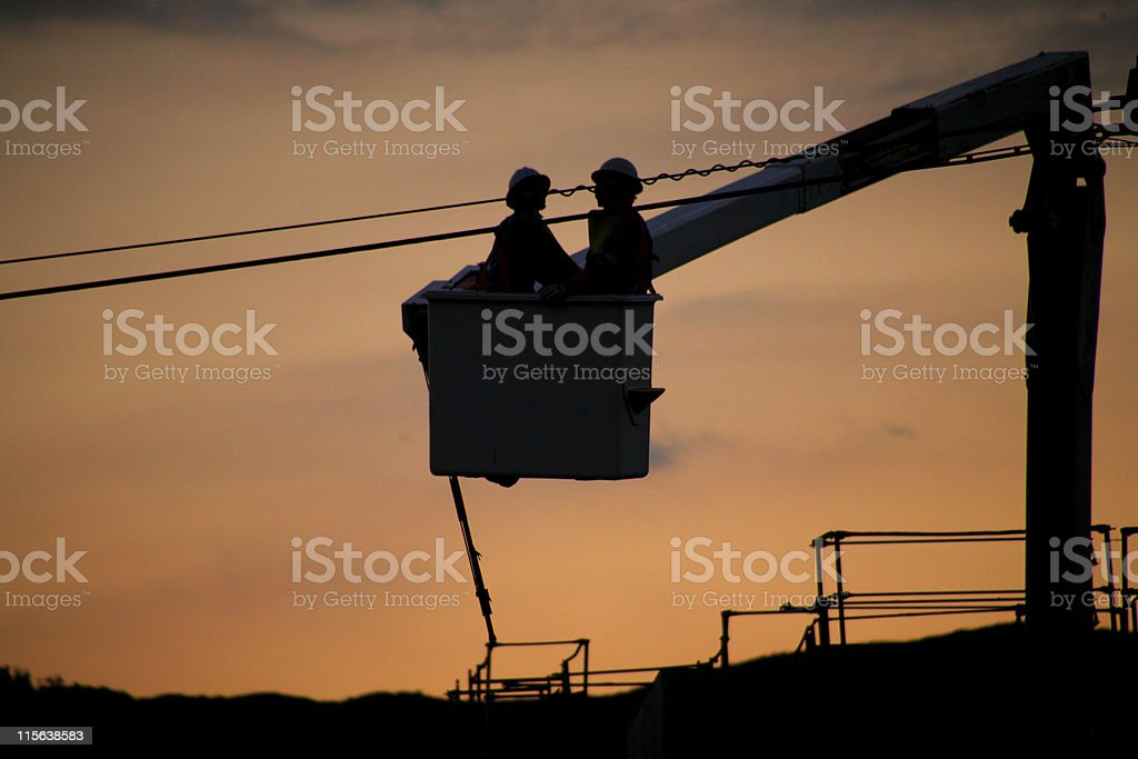 Men working on a lift stock photo