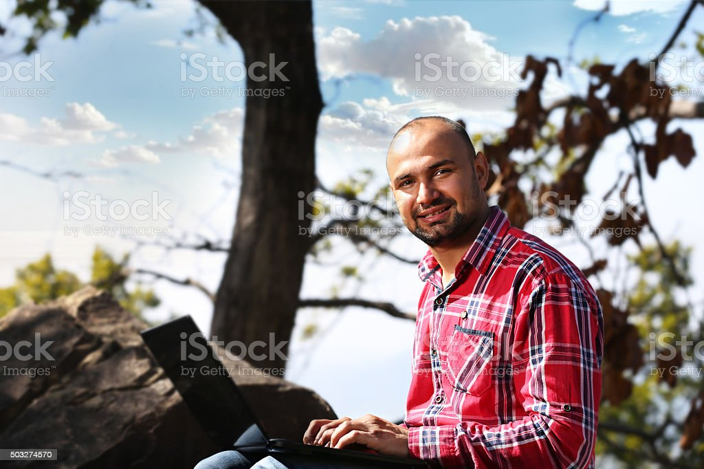 Men working on laptop Portrait in Nature stock photo