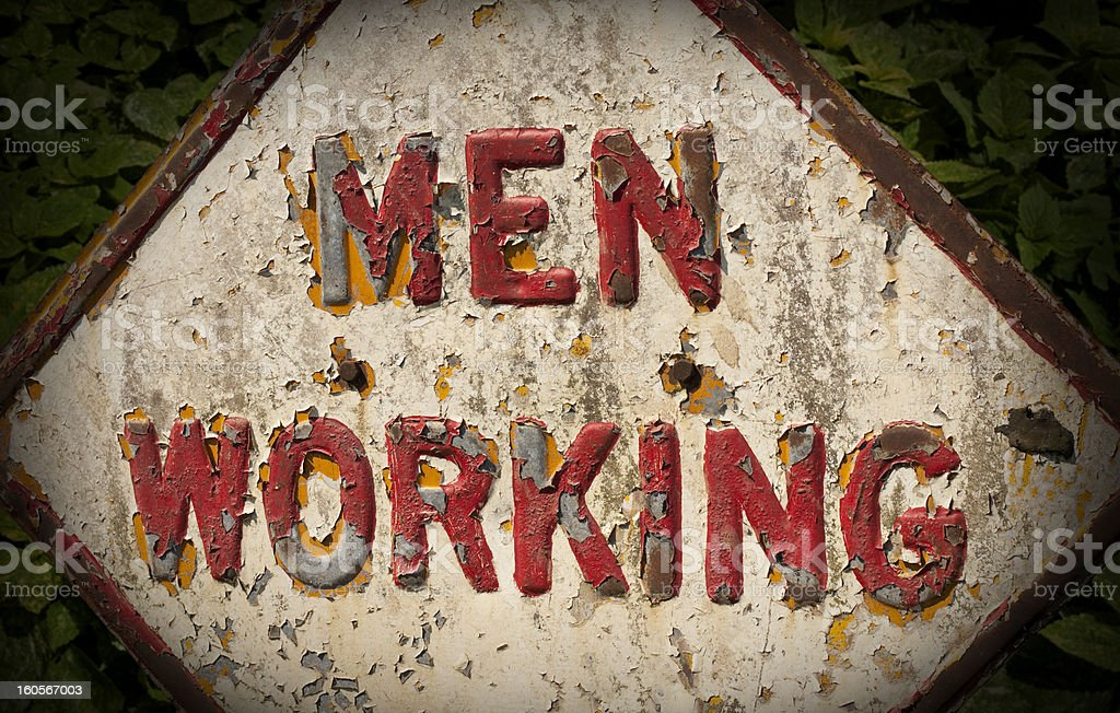 Men working sign stock photo