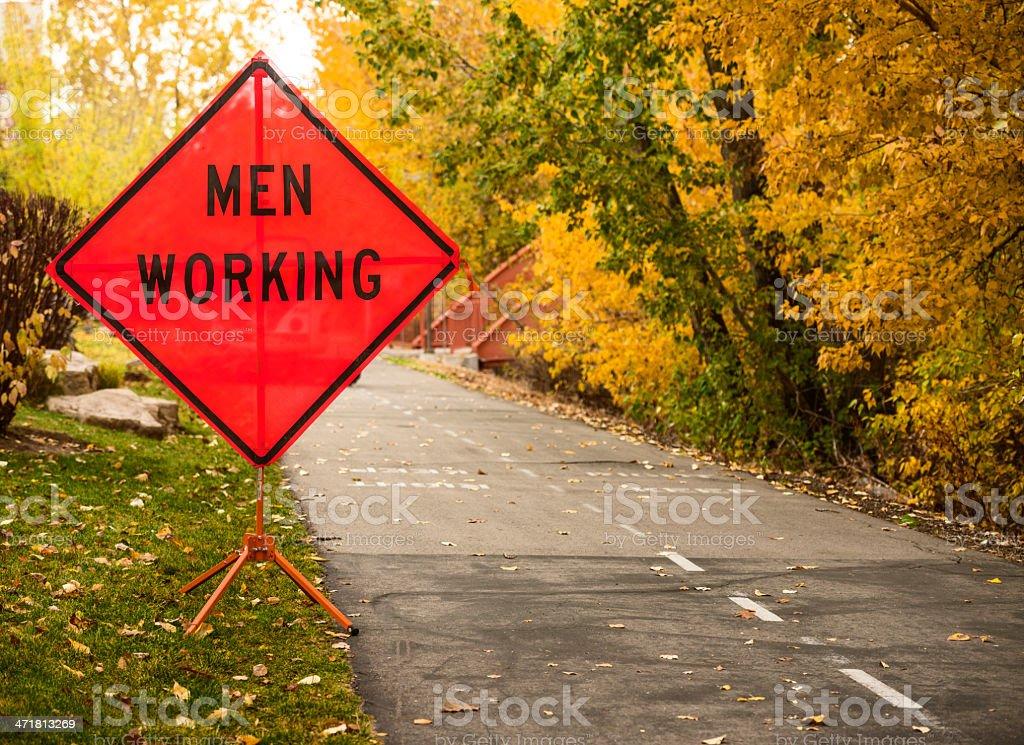 Men working signage royalty-free stock photo