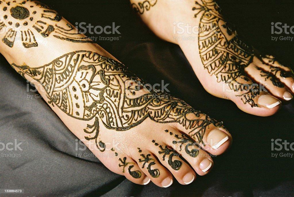 Mendhi feet stock photo