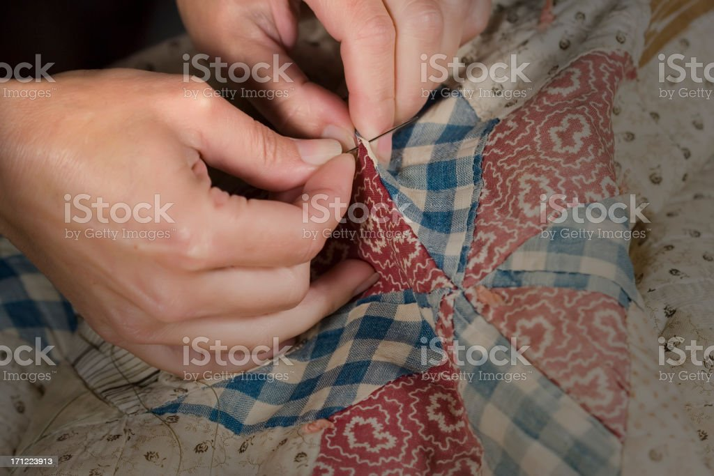 Mending Grandmothers Quilt royalty-free stock photo