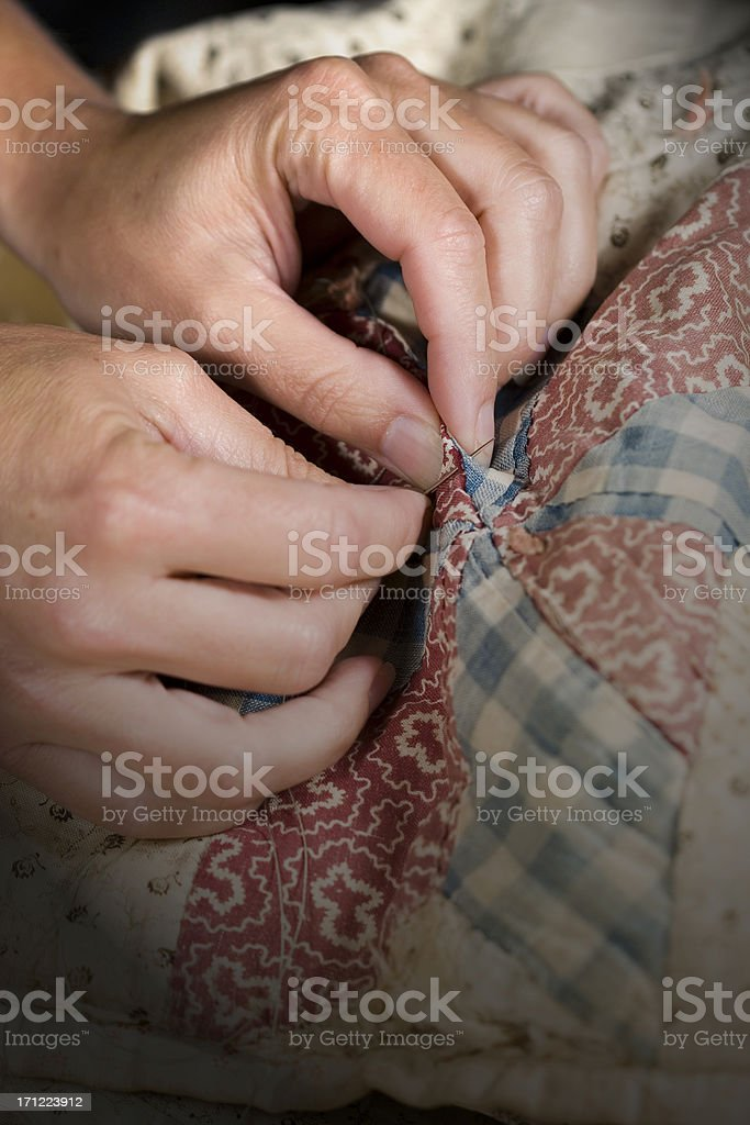 Mending the Quilt royalty-free stock photo