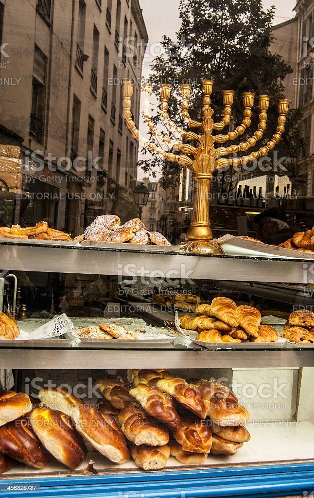Menorah in the window of a kosher bakery. Marais (Paris). royalty-free stock photo