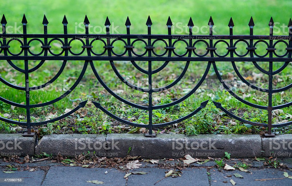 Menorah shaped iron fence royalty-free stock photo