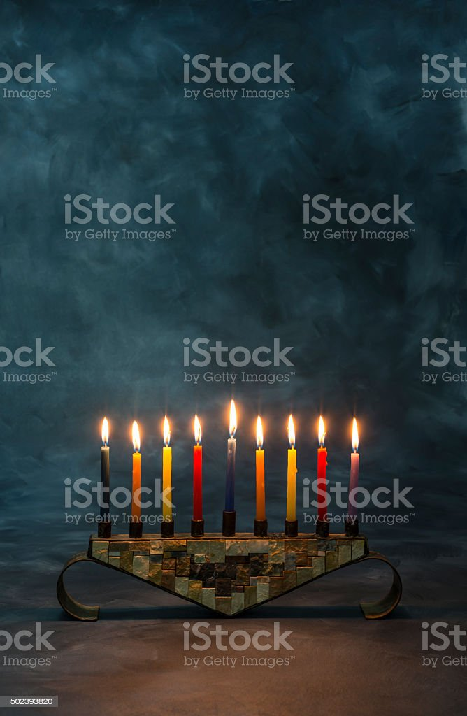 Menorah with burning candles for Hanukkah stock photo