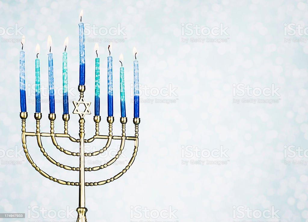 Menorah With Burning Candles stock photo