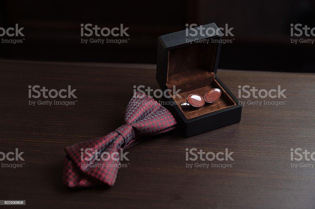 Men's accessories. Bow-tie, cufflinks. Groom details stock photo