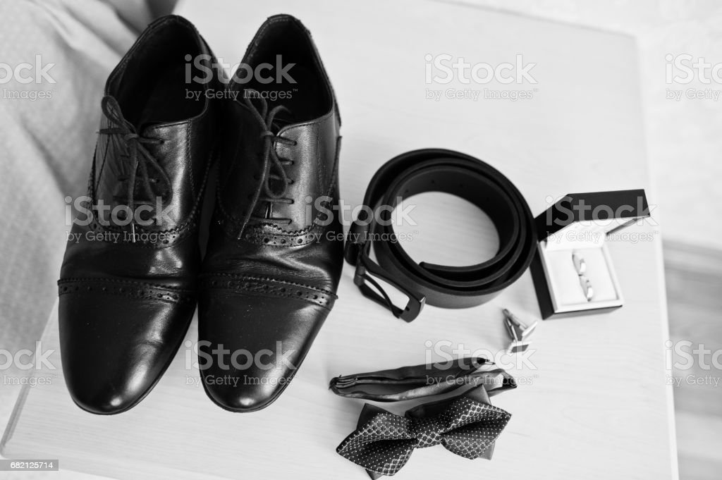 Men's accessories for groom, wedding rings, shoes, belt, cufflinks and bow tie. stock photo