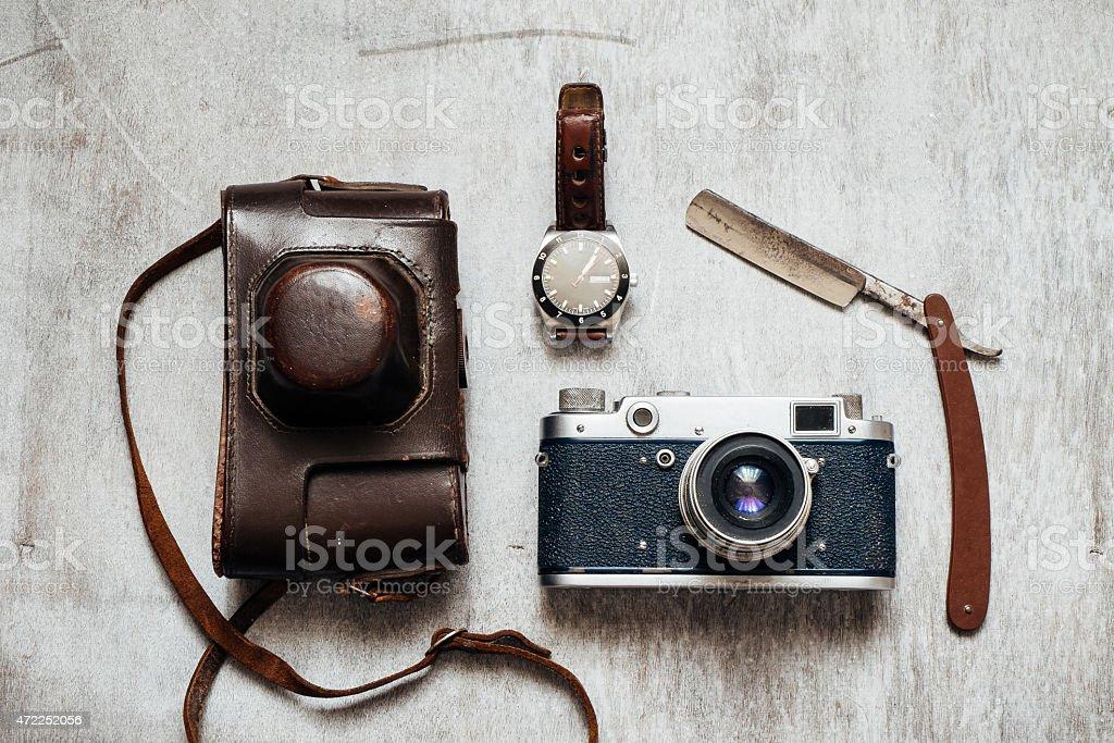 Men's Accessories , on a wooden background Retro camera watch razor stock photo