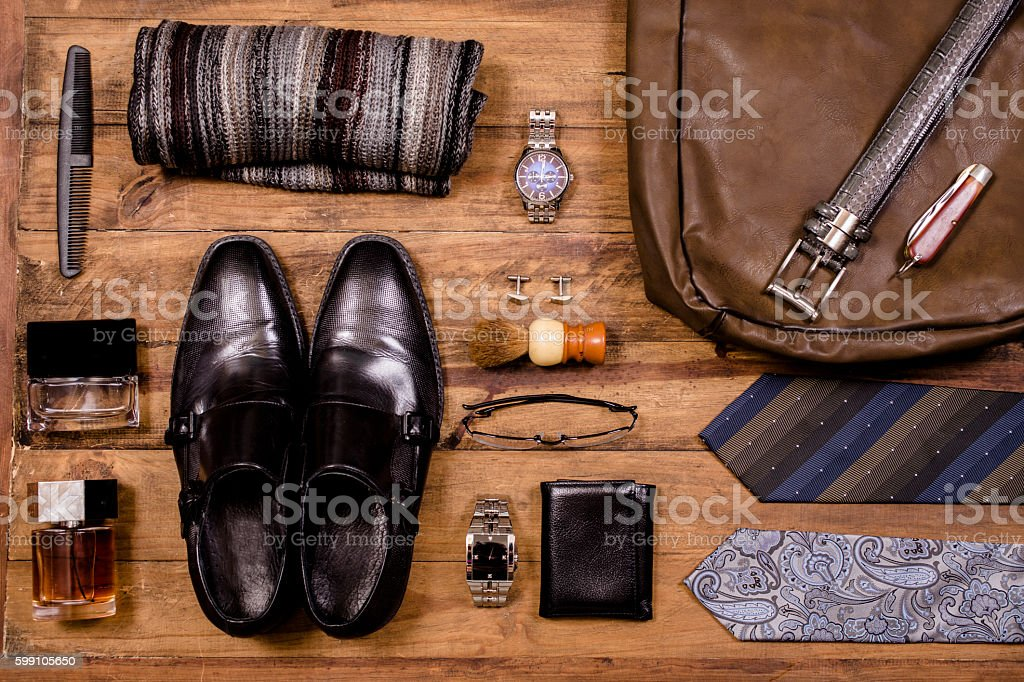 Men's accessories organized on table in knolling arrangement. stock photo