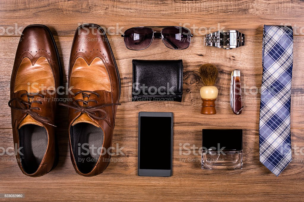 Men's accessories organized on table.  No people.  Knolling. stock photo