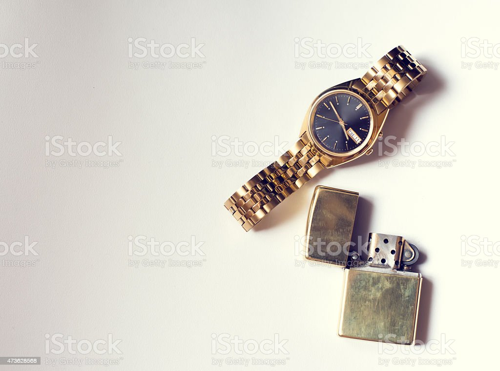 Men's accessory, golden watch and lighter on white background vector art illustration