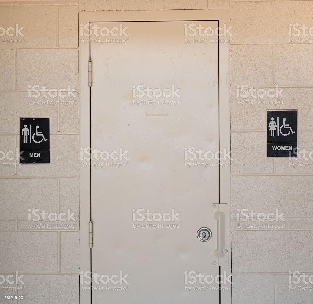 Men's and Women's Bathroom Signs stock photo