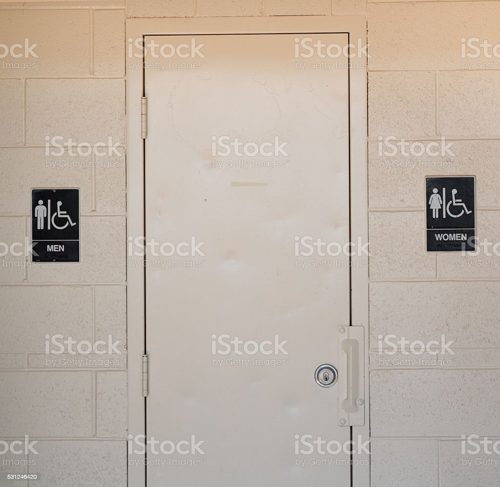 Men's and Women's Bathroom Signs stock photo