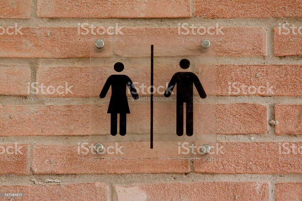 Men's and women's toilet sign stock photo