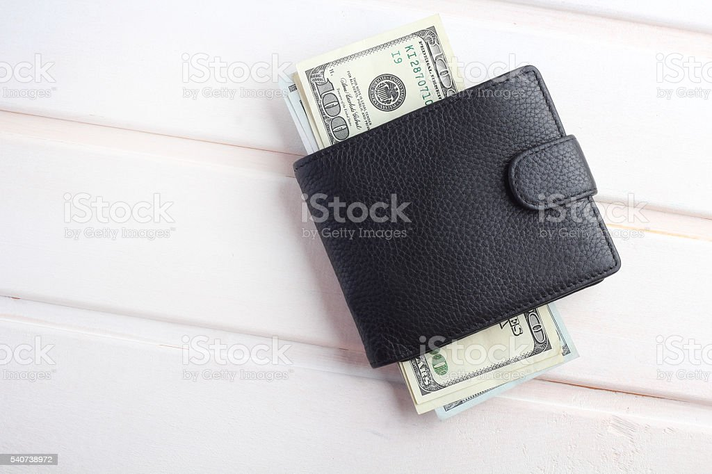 men's black wallet money in cash wooden white vintage background stock photo