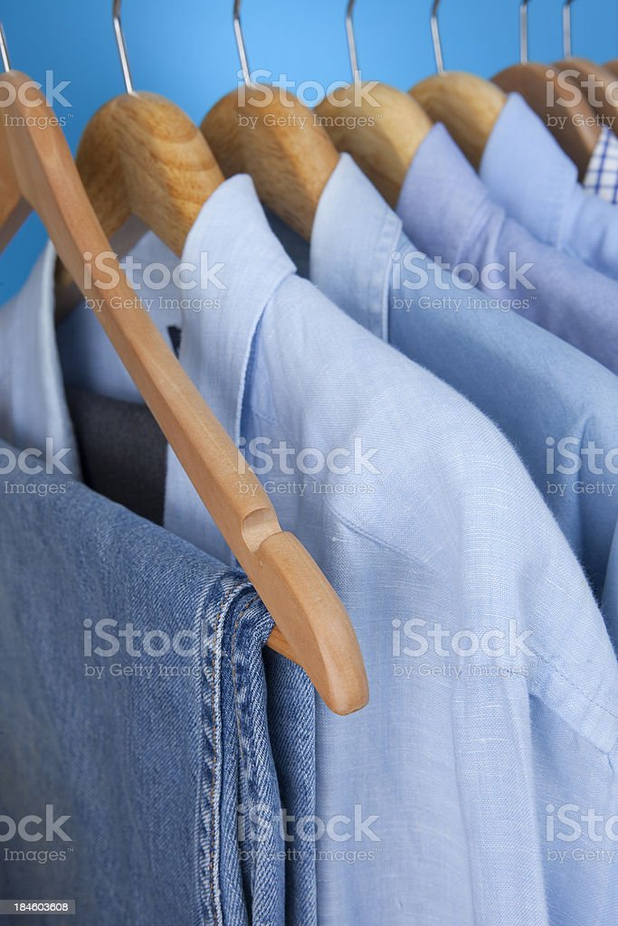 Mens Blue Shirts And Jeans On Hangers royalty-free stock photo