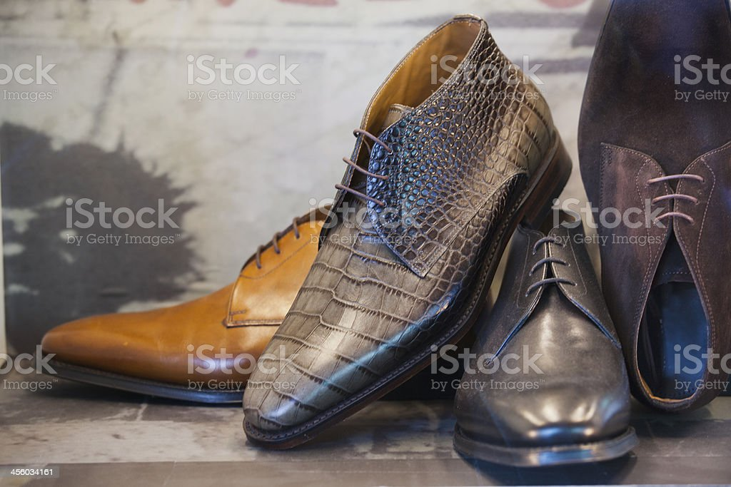 Men's brown leather pointy dress shoes on display stock photo