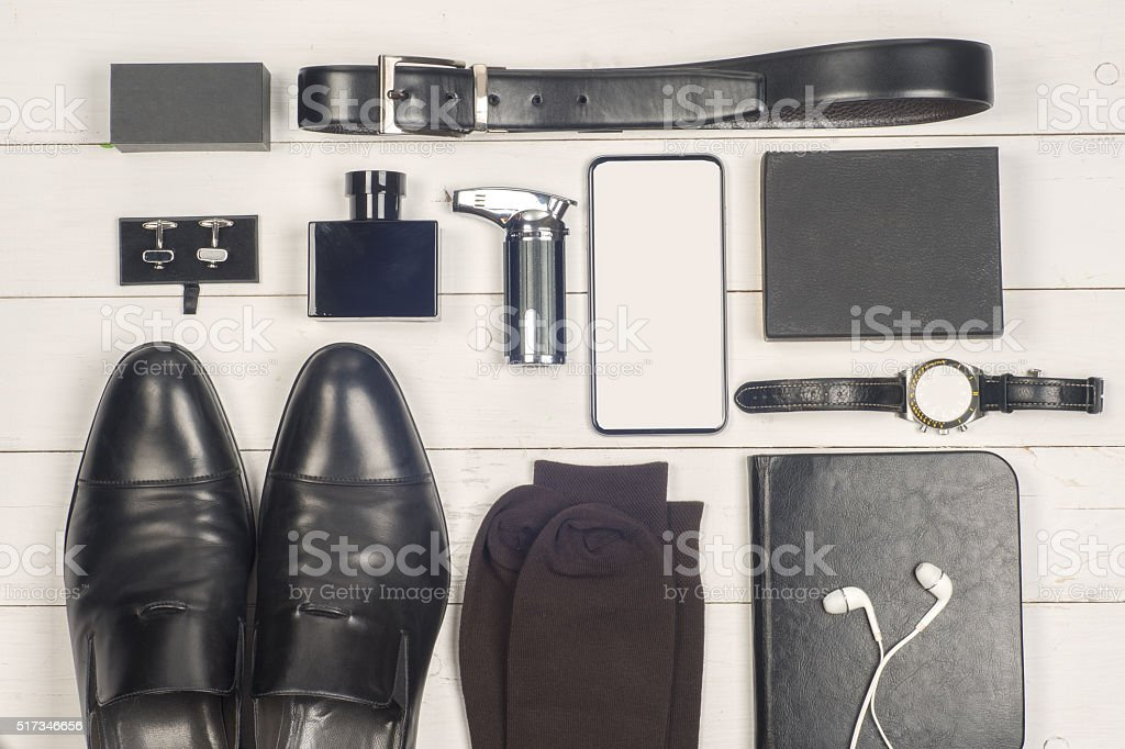 Men's casual clothes and accessories on wooden background. stock photo